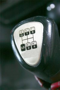 Gear shifter of a semi-truck symbolizes season of shifting gears