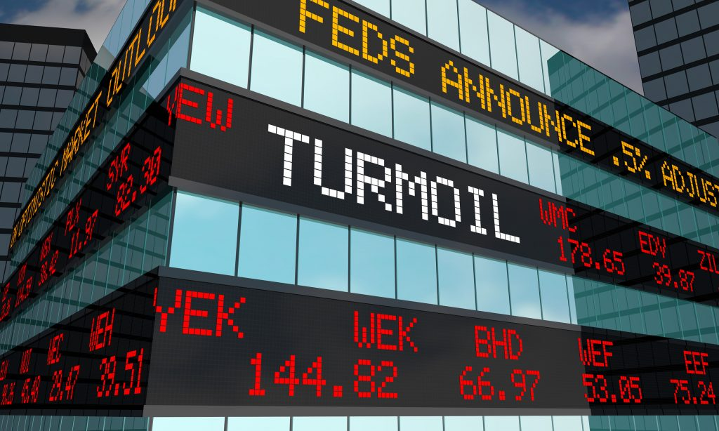"""Turmoil"" runs across a stock ticker. All stocks are down."