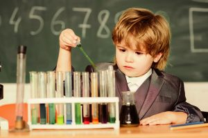 Young boy conducting science experiments similar to the science experiments driver recruiters conduct on facebook