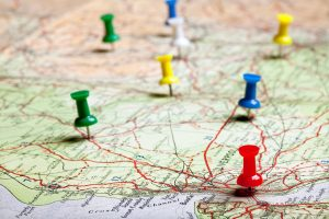 Road trip to see the country plotted out with pushpins on a map