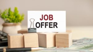 Motivational words: JOB OFFER. piece of paper with the text: JOB OFFER. Business and finance concept
